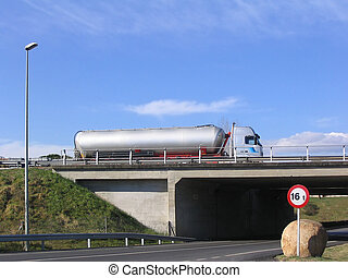Tanker truck on the road crossing a bridge