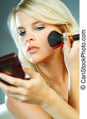 Girl doing makeup - Sexy blonde young woman doing makeup