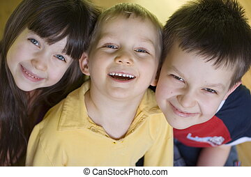 smiling kids - sister and brothers
