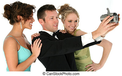Man Woman Formals - Handsome man in tuxedo with two...
