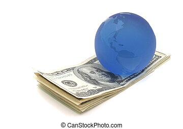 Money Stack - Money stack under blue globe paperweight