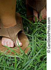 babys feet - baby walking in sandals