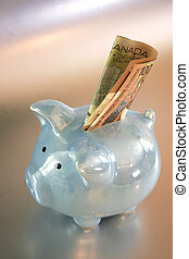 blue piggy bank - Blue ceramic pig on silver background with...