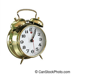 Alarm Clock - Brass Alarm Clock on reflective silver...