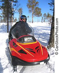 Snowmobile racing - Man riding a red snowmobile