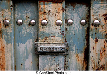 Letter box - Old rusty blue gate with letter box