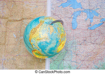 global - globe standing on a map showing America - Globus...
