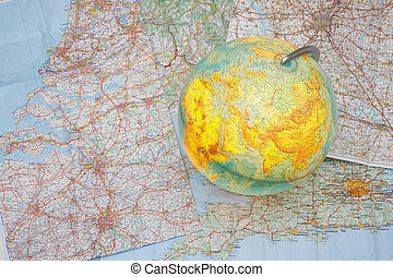 World in europe - Globe standing on a map showing europe -...