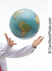 Be careful! - World floating over two hands - Weltkugel...