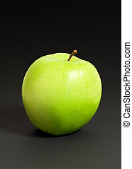 Green apple - An green apple isolated on a black background