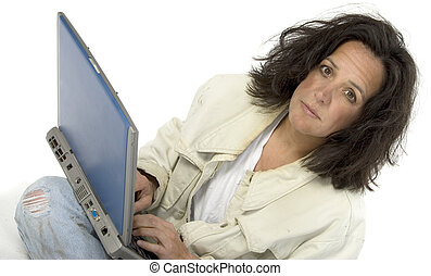 Impoverished Woman with Laptop - Woman with laptop in torn...