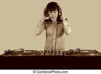 funky female dj - an image of a funky female dj, mixing on...
