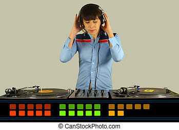 funky female dj - a funky female dj, mixing on turntables...