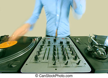 long exposure of funky female dj - a long exposure shot of a...