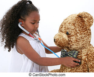 Check Up - Adorable young girl giving large bear a health...