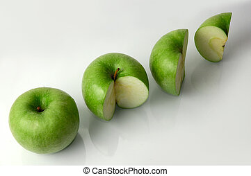 Apples - Four green apples on a table, white background,...
