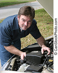 Handsome Mechanic Under Hood - A handsome auto mechanic...