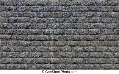 Wall 7 - A grey granit wall stone brick texture background