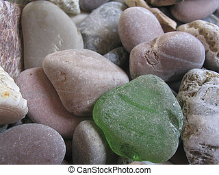 On beacsh - Small stone - focus on first stone