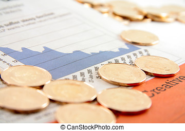 financial pages - golden coin on the financial pages of a...