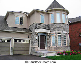 Stone and Stucco House - Taupe stone and stucco home with...