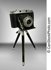 Vintage Rangefinder Camera on Tripod isolated