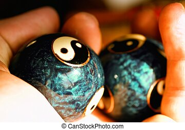 Ying Yang balls in hand