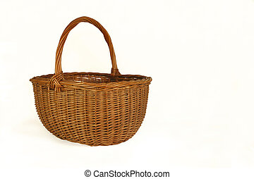 Wicker Basket - Wicker basket against a white background.