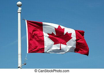 Canadian Flag - The flag of Canada on blue sky background