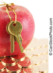 Golden key and red apple, concept of success