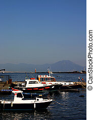 Boats at Naples - Boats docked with Mt. Vesuvius in the...