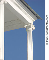 White columns against blue sky