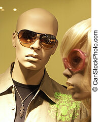 Mannequins in store with clothes. Man & Woman, focus on Man....