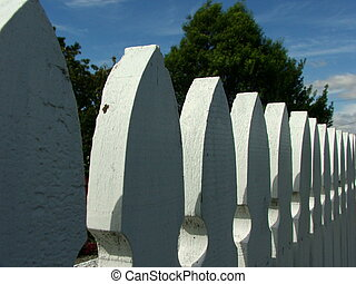 Picket line - Tops of white-painted picket-fence