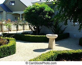 For the birds - Bird-bath in garden