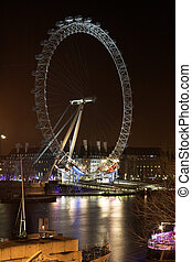 London#29 - Cityscape of the Big wheel at nighttime in...