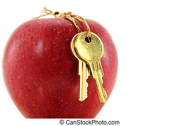 red apple and golden key