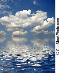 Serenity - White fluffy clouds cumulus nimbus against a blue...