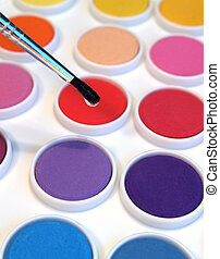 watercolors and brush - watercolor paints in rainbow colors...