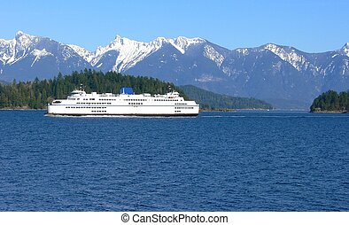 Ferry travel - A ferry passing by a small island with snow...
