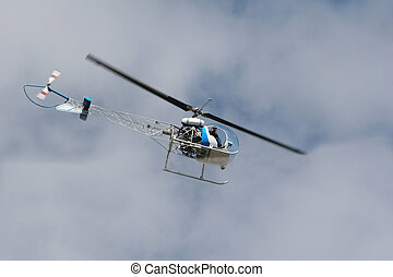 helicopter photographer - Photographer taking photos of...