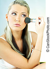 Girl doing makeup - Portrait of blonde young sexy woman...