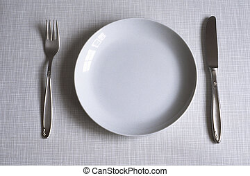 dishes on resopal - fork and knife on resopal background;...