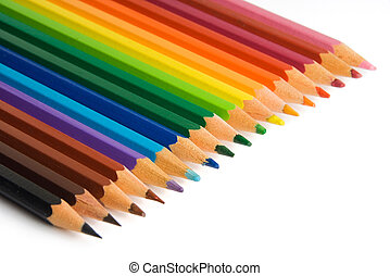 Color pencils aligned in a rainbow pattern on a white...