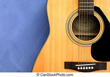 Acoustic guitar in blue background - An acoustic guitat in...