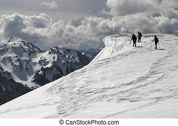 Ice Cornice - Three climbers approaching a cornice of ice...