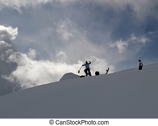 Snowboarder Fun - Two snowboarders building a jump ramp for...