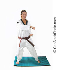 Woman Karate - Young woman in karate pose