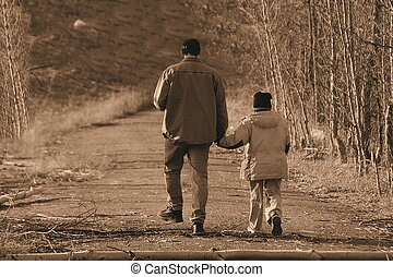 Just you and I - walking down a path, son and father