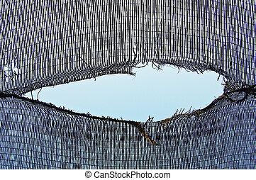 Torn net - Gaping tear in a plastic net